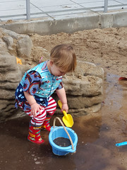 Scooping sand into a bucket (quinn.anya) Tags: playing bucket toddler sam mud totland
