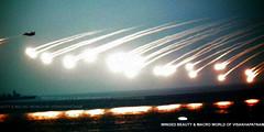 RAINING-BULLETS (prem swaroop) Tags: review navy illumination helicopter international fleet tanker warship mig amphibious demonstation warships visakhapatnam tankder