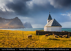 Faroe Islands - Vidoy Island - Classic view of Vidareidi church with cliffs of Bordoy and Kunoy islands ( Lucie Debelkova / www.luciedebelkova.com) Tags: travel light panorama mountain tourism church nature water beautiful landscape denmark outdoors dawn scenery worship europe mood view lumire awesome scenic atmosphere stormy paisaje beaut danish stunning vista remote serene nordic scandinavia paysage exploration landschaft danmark faroeislands breathtaking paesaggio scandinavian evropa northerneurope magiclight faroes froyar dramaticlight frerne nordiccountry faroese kingdomofdenmark kongerigetdanmark noroyar viareii vioy vidareidi luciedebelkova wwwluciedebelkovacom scandinavianregion vioyisland