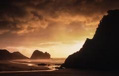 Lion in Silhouette (zebedee1971) Tags: newzealand orange sun beach silhouette landscape sand stream waves hill auckland lionrock