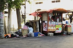 i'm only sleeping (DOLCEVITALUX) Tags: sleeping people hot outdoor philippines tired manila midday