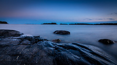 After the sunset (Mika Laitinen) Tags: ocean longexposure blue sunset sea sky cloud sun seascape nature water rock suomi finland landscape twilight helsinki europe outdoor dusk wideangle calm balticsea shore serene scandinavia nightfall vuosaari uutela canon7dmarkii