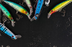 Colorful Fishing Lures on black glass (Dariia_Belkina) Tags: fish color nature wet water glass sport metal set danger drops fishing shiny aqua bass group cyan deep fake floating artificial knot hobby spray sharp plastic equipment spinning catch leisure diver twitching shallow trout pike minnow seductive tool tackle bait attraction lure jerk hooks alluring crank freshwater fishhook wobbler angling