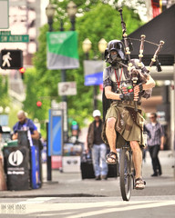 The Unipiper (Ian Sane) Tags: street camera two man southwest oregon canon portland lens ian photography eos star weird is downtown mark candid helmet broadway images ii darth unicycle 5d wars usm vader bagpipes alder sane ef70200mm f28l theunipiper