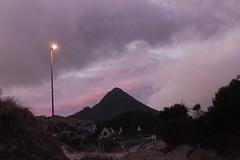 The beacon (Michele's POV) Tags: sky mountain skyscape evening twilight dusk dune breathing homelights lighttheway cloudtrails insideoroutside isthebeaconthelightorthemountain blanketofsoftness villageintheleeofthemountain