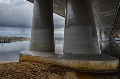 Framing the city (Ralph Green) Tags: bridge rain clouds australia perth pylons westernaustralia hdr cityskyline perthskyline canningriver mounthenrybridge hdreffectspro2
