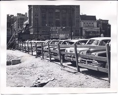 """Parking outside the movie theatre, showing Spencer Tracy in """"Broken Lance"""" (Living Vintage) Tags: park old city urban blackandwhite bw building history cars sign america vintage fence movie found parkinglot theatre antique historic vehicles spencertracy"""