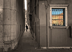And just for fun, a selective colored window to stress the colorful reflections in the glass (VillaRhapsody) Tags: venice italy window buildings walking person one alley travels venezia narrow venedig distant selectivecoloring reflecitons challengeyouwinner