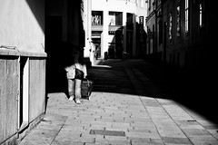 out of the dark (schalkandreas) Tags: vienna street camera people blackandwhite bw prime austria flickr moments faces candid streetphotography scene andreas menschen 55mm creativecommons monochrom schalk schalkandreas