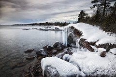 graffiti rock / sawpit bay / winter (twurdemann) Tags: longexposure winter sky snow seascape ontario canada nature water landscape graffiti rocks horizon shoreline january scenic calm icicle lakesuperior northernontario stonebeach neutraldensityfilter nikcolorefex viveza glamourglow sawpitbay highway17n procontrast whiteneutralizer hoyandx8 06ndsoftgrad detailextractor gnd2s xf14mm leeseven5 fujixt1 brilliancefilter cottrellcove