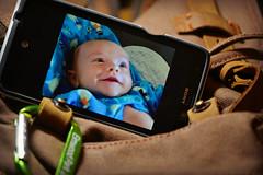 Word has It... (MTSOfan) Tags: baby smile photo cellphone grandchild bookbag flynn