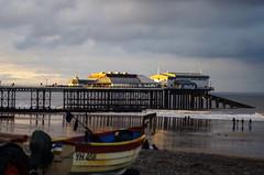 Cromer pier (rachappleby) Tags: winter sea sun beach boats evening coast pier sand shadows norfolk figures cromer