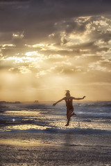 (Rebecca812) Tags: ocean portrait sky reflection water girl clouds sunrise canon jump child candid joy girlpower midair athlete carefree underarmour dauphinisland feedom activelifestyle rebecca812