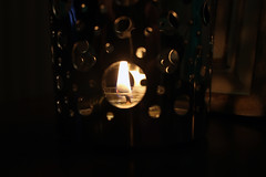 Flickering flame (ashleyk.wiebe) Tags: light shadow fire candle flame heat flicker