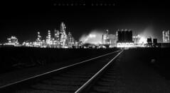 Train To Oil City (vs_foto) Tags: vienna wien city urban industry architecture night austria blackwhite cityscape nightshot oil rails heavyindustry guessedvienna