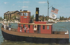 SHIP Ludington MI TUG BOAT ANNIE 50 Steel Tug Passenger Vessel & Tourist Ferry took passengers from Buttersville Crosswinds Condo to the City Marina & Tugboat Annies Restaurant &  Lounge1 (UpNorth Memories - Donald (Don) Harrison) Tags: travel usa heritage history tourism st vintage antique michigan postcard memories restaurants hotels trailer roadside upnorth steamship cafes excursion attractions motels mackinac cottages cabins campgrounds city bridge island car upnorthmemories rppc wonders big railroad michigan memories mac state parks entertainment natural harrison roadside ferry travel don tourist mackinaw stops upnorth straits ignace