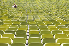 Alone (C_MC_FL) Tags: abstract green texture lines architecture canon germany lesen munich mnchen deutschland person photography eos reading alone pattern sitting fotografie geometry stadium empty leer row arena negativespace seats repetition architektur grn stadion frau tamron muster sessel repeating olympiastadion geometrie sitzen linien sitzplatz textur reihe alleine 18270 60d b008 hintereinander