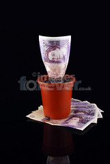 Money Pot on Stack (the UMF) Tags: england brown money reflection english out big purple cut bank save clip cash company growth soil 100 growing saving financial firm bigger loan expanding finance rolled invest lend clipped