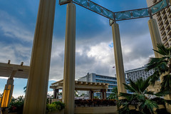 Pillars and dramatic sky (Victor Wong (sfe-co2)) Tags: blue light sky usa white building beach monument nature beautiful weather stone architecture clouds hawaii hotel natural waikiki outdoor famous sightseeing pillar scenic dramatic landmark resort pole hyatt column honolulu pillars spa cloudscape regency attraction
