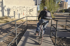 Downtown, no. 16 (GC_Dean) Tags: street city arizona urban color building tree colors phoenix bicycle graffiti flora downtown cityscape colours cyclist shadows space structure sidewalk railing mundane emptiness urbanlandscape earlymorninglight urbantree sociallandscape
