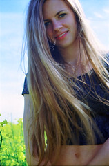 Anne (Juliet Alpha November) Tags: portrait film field analog 35mm hair anne jump kodak jan outdoor feld rape 100 analogue raps haare rapeseed ektar meifert seestdt