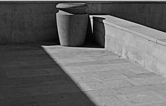Patio Shadows (John Jardin) Tags: blackandwhite sunlight abstract urn stone outdoors shadows exterior bright angles patio tiles