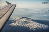 Flying over Mt. Etna (augello.info) Tags: from above travel winter sky italy mountain snow tourism clouds airplane landscape volcano fly flying wings view wing superior landmark aerial mount destination sicily etna catania sicilia overthetop superiority 500px