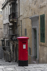 Red letter box (kurjuz) Tags: red oldbuildings malta balconies desaturated valletta pillarpostbox triqsanduminkucornerwitholdbakerystreet