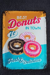 Donuts ad on a metal plate (Mateusz Adamus) Tags: metal closet olympus cleaning donuts plates advertisements