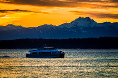 Water Taxi Last Call (jetcitygrom) Tags: seattle county blue sunset portrait orange mountains nature water ferry canon landscape foot bay boat washington king brothers yacht taxi alki olympic elliot doc maynard 70d