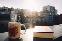 . (Helena Barker) Tags: morning light maana coffee breakfast sunrise relax reading book cafe quiet tea alba terrace balcony leer libro calm literature read amanecer mug te sunrays desayuno balcon taza calma terraza literatura sunray calmness quietness rayosdesol tranquilidad relajacin svetlanaaleksievich alexivich elfindelhomosovieticus