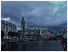 Hamburg at dusk (kurtwolf303) Tags: city sky topf25 water clouds buildings germany dark twilight topf50 topf75 wasser europe cityscape 500v20f cloudy dusk cityhall hamburg himmel wolken stadt townhall dmmerung rathaus topf100 gebude dunkel omd wolkig stadtansicht 900views 1000v40f 250v10f lovelycity unlimitedphotos micro43 microfourthirds olympusem5 kurtwolf303