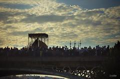 Cruzando el Guadalquivir (Elizabeth Padilla) Tags: sky espaa contraluz sevilla andaluca spain cielo virgen semanasanta pentaxk5