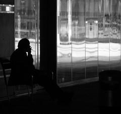 Smoking (C_MC_FL) Tags: vienna wien street blackandwhite bw man reflection window silhouette canon photography eos blackwhite sterreich waiting alone fotografie cigarette fenster streetphotography smoking sw mann smoker tamron reflexion spiegelung reflektion raucher zigarette rauchen warten alleine schwarzweis kontur 18270 60d b008