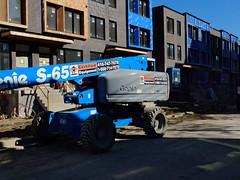 Blue Genie (geowelch) Tags: toronto downtown shadows constructionsite heavymachinery urbanlandscape urbanfragments fujifilmx10