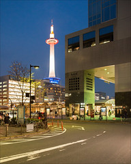 kyoto-1212-ps-w (pw-pix) Tags: road street city windows sky people urban tree tower lines japan night fence buildings dark lights high kyoto colours bicycles railwaystation shops pedestrians tall walls lit shelter coloured markings offices bollards busterminal kyototower kyotostation