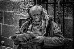 No news is good news (Sbastien Gross) Tags: blackandwhite woman 35mm newspaper fuji candid streetphotography auvergne 2016 marcket x100 project365