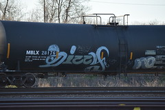 DIZZY (TheGraffitiHunters) Tags: street white black green art train graffiti colorful paint tracks spray oil dizzy freight tanker benched benching