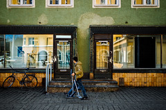 The lifelike Loxia 2/35 (Toni Ahvenainen) Tags: street windows light reflection zeiss walking person spring windowcleaner loxia235