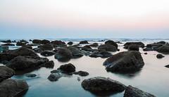 Calm Before The Storm (arnabjosephite) Tags: longexposure sea beach nature coral rocks peace slow calm shore slowshutter shutter serene stillwater bangladesh bazar coxs beache coxsbazar inani inanibeach longestbeach longestnaturalbeach