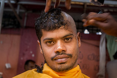 A Streetside Shave (tylerkingphotography) Tags: street travel portrait people orange india man color colour face look festival hair lens temple person photography eyes nikon southeastasia glare photographer outdoor head candid indian religion watching culture celebration explore caves event human backpacking shaving barber malaysia shave kit kualalumpur 1855mm traveling tradition devotee hindu hinduism amateur batucaves thaipusam malay hairdressing kavadi lordmurugan d3100