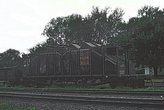 CNW Hopper 62713 on Flat 48497 in  Clinton, IA on August 12, 1964 (railfan 44) Tags: chicago northwestern
