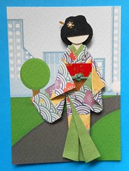ATC1309 - Geisha in the modern city (tengds) Tags: street city flowers red white tree green yellow atc artisttradingcard buildings asian japanese gold waves purple geisha kimono obi origamipaper papercraft japanesepaper washi ningyo artistcard handmadecard chiyogami asiandoll moderncity yuzenwashi japanesepaperdoll nailsticker origamidoll kimonodoll nailartsticker tengds