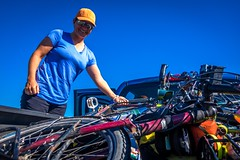 Amanda struggling to unload our bikes from the back of the truck.