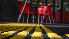 Yellow Tactile Indicators (Theen ... busy) Tags: park roof red glass yellow table lumix cafe factory floor chairs steel steps ceiling plastic deck level round area adelaide split recreational adaptivereuse darkgrey flindersuniversity tonsley theen tactileindicators