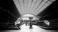 just me, and ma two trains . . (Ric George) Tags: camera old blackandwhite white black london monochrome station st architecture train vintage 50mm photo blackwhite waiting fuji grain trains retro pinhole oldphoto fujifilm pinholecamera 24mm grainy pillars stpancras pancras architecturepillars x100t