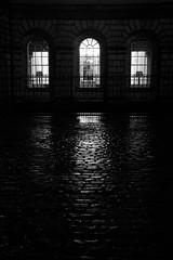 Three windows on Parliament Square (Lucky Poet) Tags: windows wet monochrome rain night dark lights scotland blackwhite edinburgh parliamentsquare cobbles oldtown