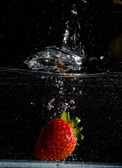Strawberrysplash5 (garlick.rachel) Tags: abstract colour macro water fruit fun strawberry dof strawberries bubbles splash watersplash