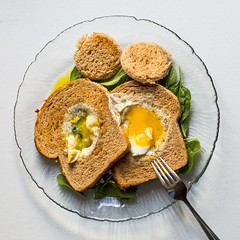 Easy over eggs in tomato herb toast over spinach (auntneecey) Tags: breakfast healthy delicious eggs savory spinach nutritious