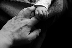 Holding on (gornabanja) Tags: old family blackandwhite baby love contrast blackwhite big hands nikon hand d70 small young mother parent